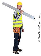 Tradesman carrying a girder