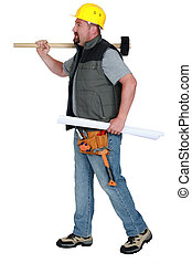 Tradesman carrying a mallet and a blueprint