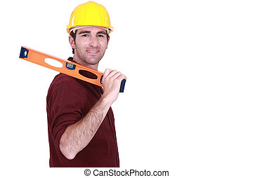 Tradesman carrying a spirit level