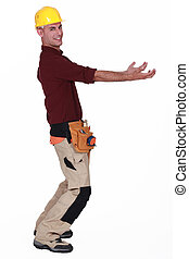 Tradesman carrying an invisible object