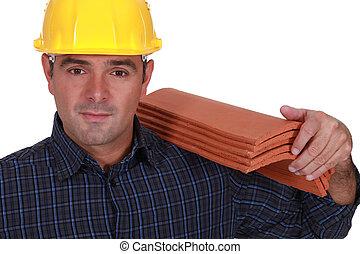 Tradesman carrying shingles
