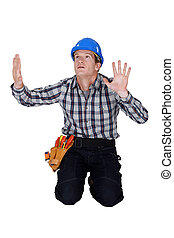 Tradesman confined by a glass wall