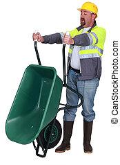 Tradesman emptying a wheelbarrow