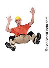 Tradesman falling backwards