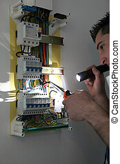 Tradesman fixing a circuit breaker