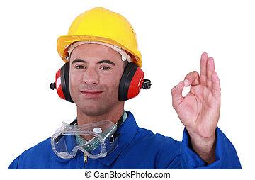 Tradesman giving the a-ok sign