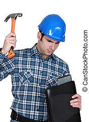 Tradesman hitting his laptop