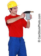 Tradesman holding a blowtorch