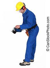 Tradesman holding a circular saw