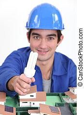 Tradesman holding a fluorescent lamp