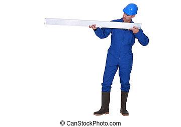 Tradesman holding a girder
