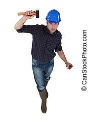 Tradesman holding a hammer