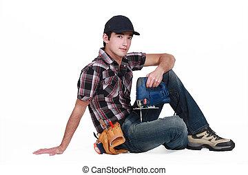 Tradesman holding a jigsaw