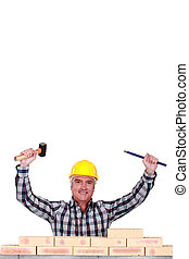 Tradesman holding a mallet and a chisel