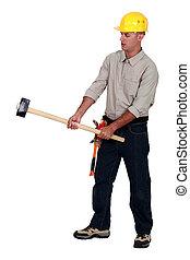 Tradesman holding a mallet