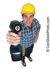 Tradesman holding a power tool