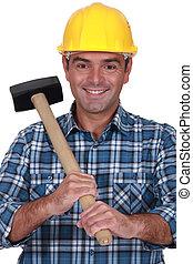 Tradesman holding a rubber mallet