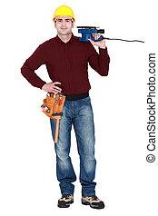 Tradesman holding a sander