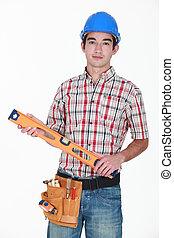 Tradesman holding a spirit level