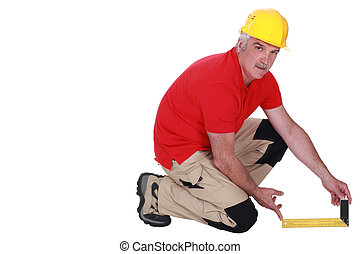 Tradesman holding a try square