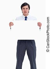 Tradesman holding blank sign