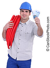 Tradesman holding money and corrugated tubing around his shoulder