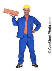 Tradesman holding terracotta shingles