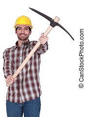 Tradesman holding up a pickaxe