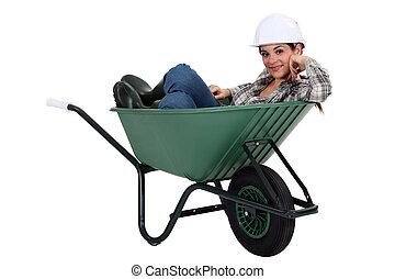 Tradesman in a wheelbarrow