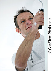 Tradesman painting a wall