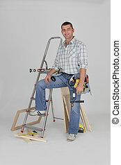 Tradesman posing with his building materials
