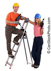 Tradesman posing with his young apprentice