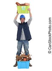 Tradesman posing with recycling bins
