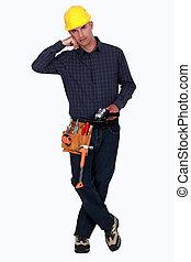 tradesman, segurando, um, ângulo, moedor
