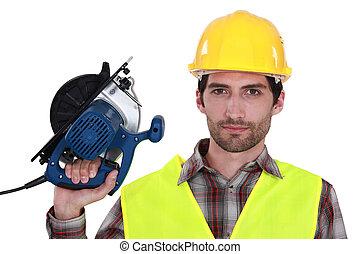 tradesman, serra, segurando, circular