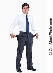 Tradesman showing his empty pockets