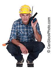 Tradesman squatting