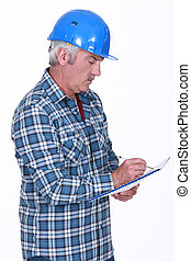 Tradesman taking notes