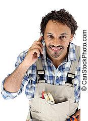 Tradesman talking on his mobile phone