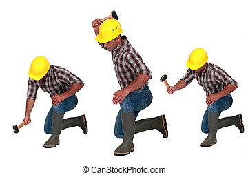 Tradesman using a hammer