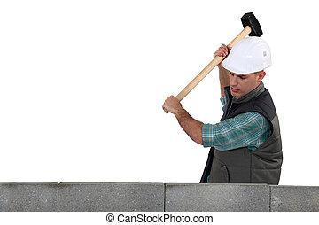 Tradesman using a mallet