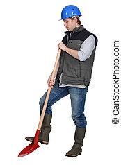 Tradesman using a spade
