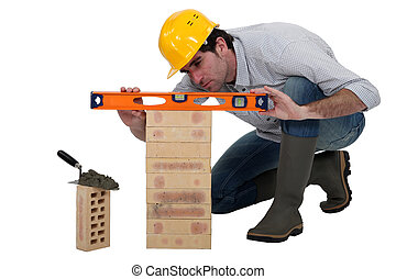Tradesman using a spirit level