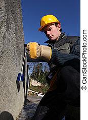 Tradesman using a tool