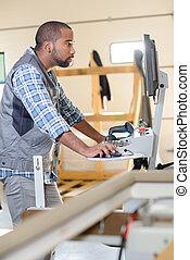 Tradesman using computer