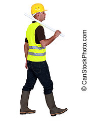 Tradesman walking on a building site