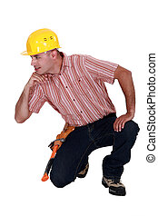 Tradesman with his elbow propped up on an invisible object
