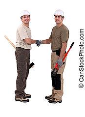 tradesmen, potrząsające ręki