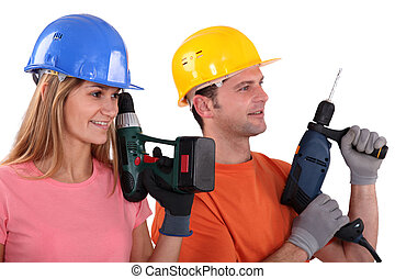Tradespeople holding power tools