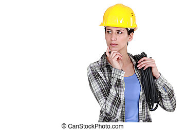 Tradeswoman deep in thought